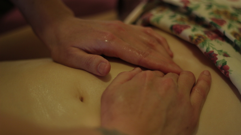 Tricia Weber, LMT, giving Abdominal Massage