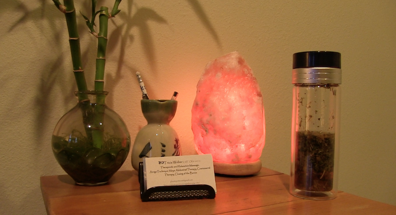 Table with plant, vase, salt lamp and cards for Tricia Weber, LMT, Plant~Spirit~Massage